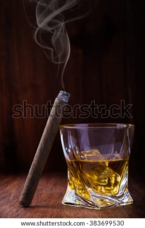 Whiskey and cigar on wooden background - stock photo