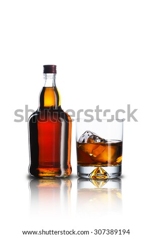 Whiskey Bottle and Glass With Ice Cubes - stock photo