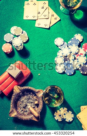 Whiskey, cigar and cards in old gambling table - stock photo