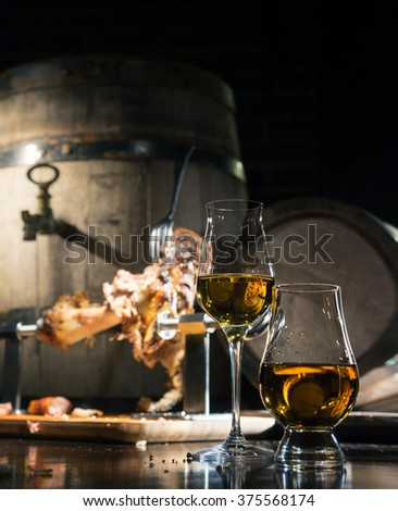 whiskey, cognac, calvados with boiled pork knuckle - stock photo