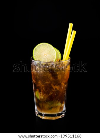 Whiskey cola Cocktail isolated on black