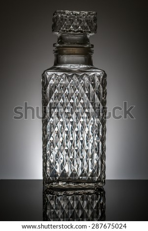 whiskey decanter with dark grey background  - stock photo