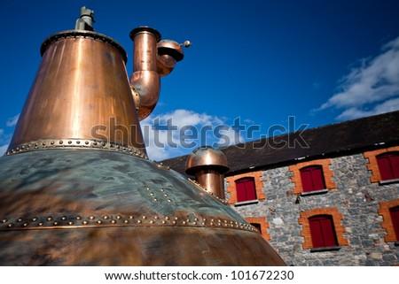 Whiskey distillery Old copper washback in Ireland - stock photo