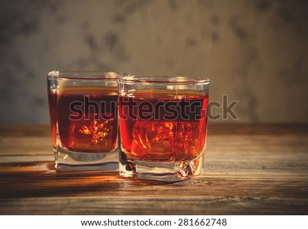 Whiskey drinks on wooden table. instagram image filter retro style - stock photo