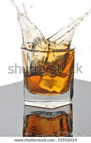 Whiskey Glass with Ice on Gray with Reflection and Splash