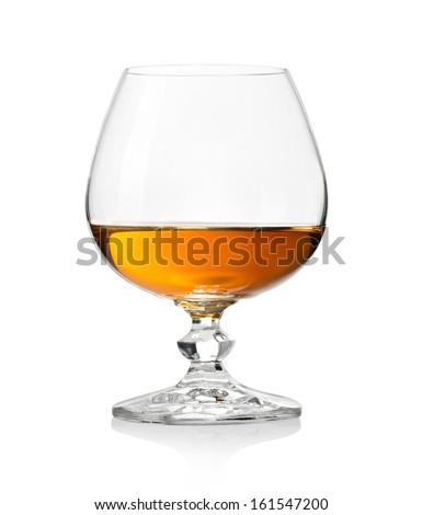 Whiskey in glass on white background - stock photo