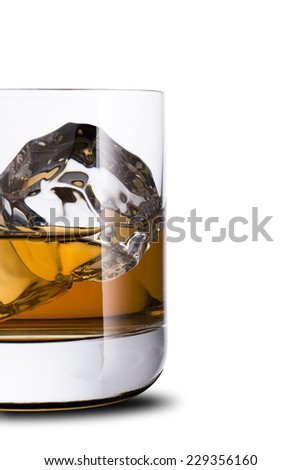 Whiskey in glass with ice cube. On the rock
