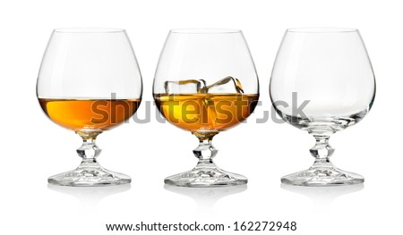Whiskey in glass  with ice on white background - stock photo
