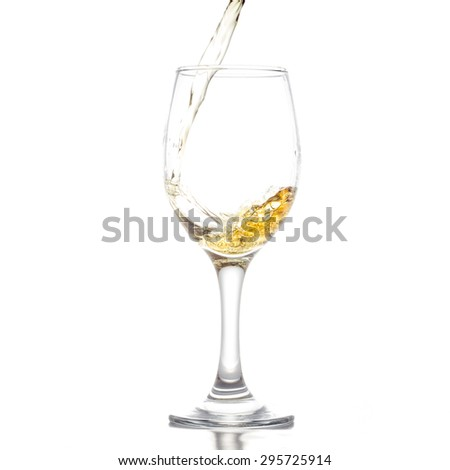 whiskey in wine glass on white background