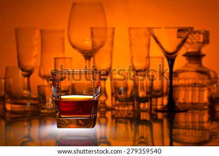 whiskey on a glass table in bar - stock photo