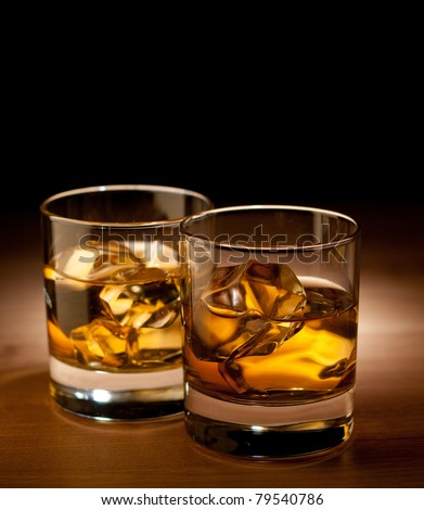 whiskey on the rocks, black background - stock photo