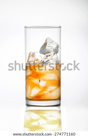 Whiskey on the rocks in a glass - stock photo
