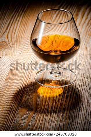 Whiskey or brandy on a wooden table - stock photo