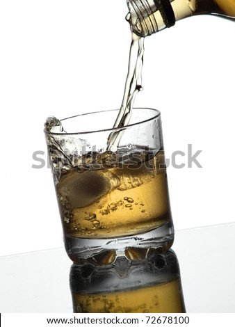 Whiskey pouring into a glass - stock photo
