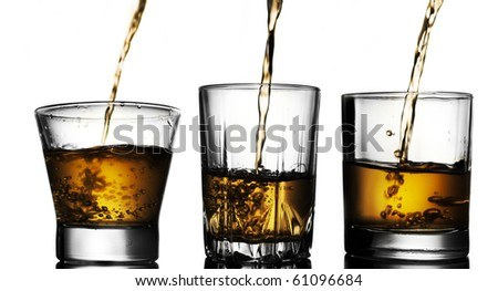 whiskey pouring into glasses