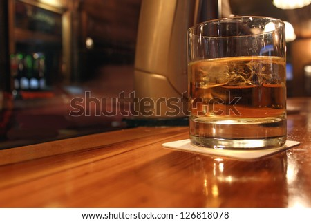 whiskey served in a pub - stock photo