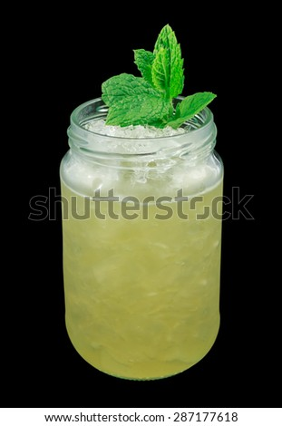 Whiskey smash is a cocktail that contains whiskey, sugar, lemon and mint. Garnished with a mint twig. Isolated on black. - stock photo