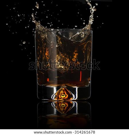 Whiskey Splash On Black Background - stock photo