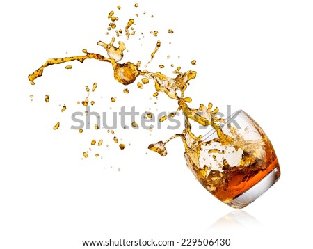 Whiskey splash with drops - stock photo
