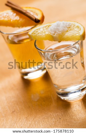 Whiskey, tequila with lemon and cinnamon