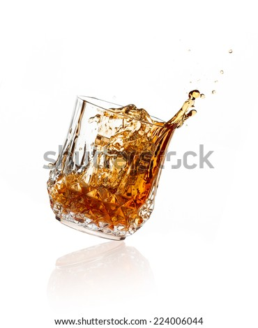 Whiskey toast. whiskey on glass of cut glass over white background - stock photo