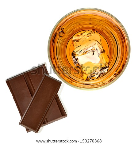 Whiskey with chocolate bars on white background - stock photo