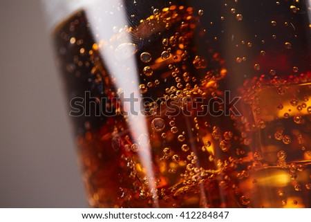 whiskey with cola with ice closeup