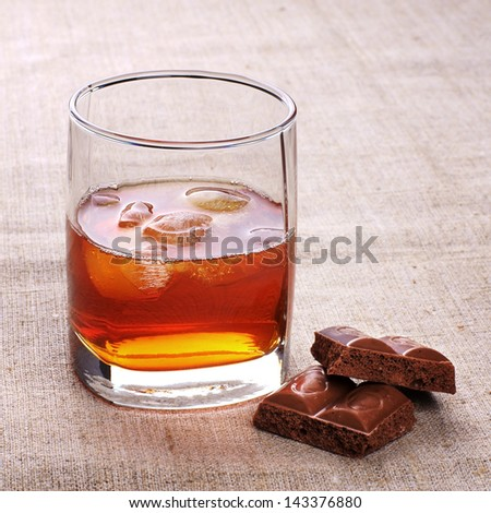 whiskey with ice and chocolate - stock photo