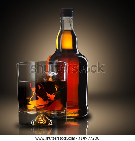 Whiskey With Ice Cubes On Wood Table - stock photo