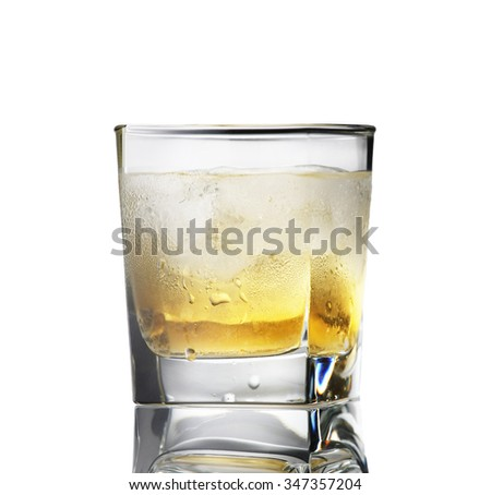 whiskey with ice in a sweaty glass on a white background isolate - stock photo