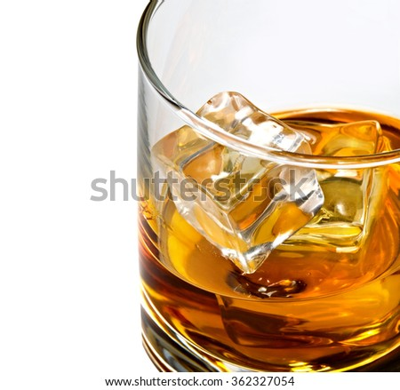 Whiskey with ice in rocks glass detail shot - stock photo