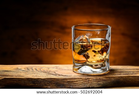 whiskey with ice on a wooden table