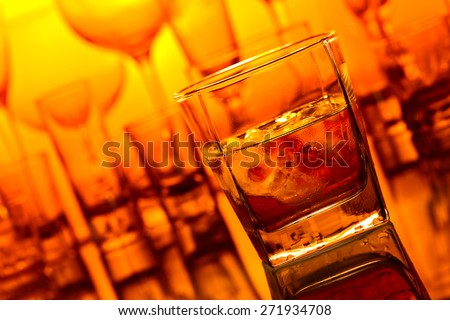 whiskey with natural ice on glass table in bar - stock photo