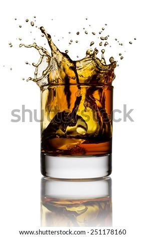 Whisky splash isolated on a white background - stock photo