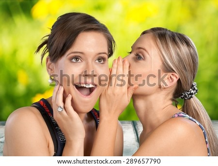 Whispering, Women, Friendship. - stock photo