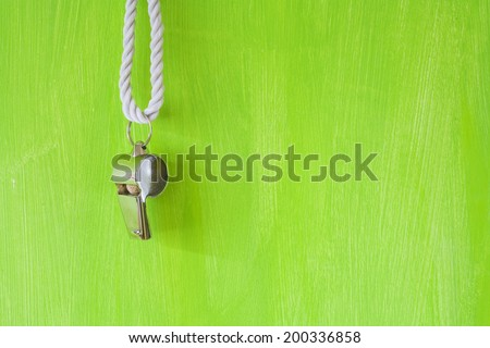 whistle of a soccer / football referee, free copy space - stock photo