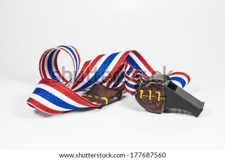 whistles with Thailand national flag lanyard on white background - stock photo