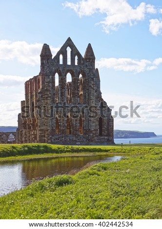 Whitby Abbey and North Sea in North Yorkshire in England. It is ruins of the Benedictine abbey. Now it is under protection of the English Heritage. - stock photo
