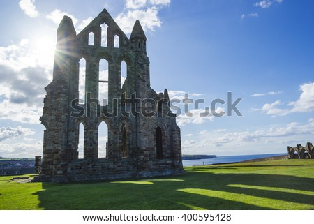 Whitby Abbey at sunset in North Yorkshire in England. It is ruins of the Benedictine abbey. Now it is under protection of the English Heritage. - stock photo