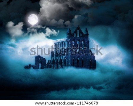 Whitby Abbey, North Yorkshire Coast, UK in Moonlight and Fog - stock photo