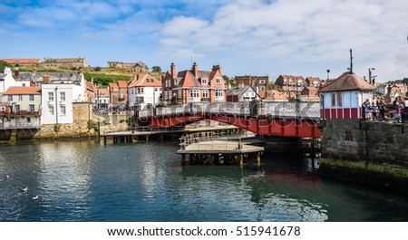 WHITBY, ENGLAND - AUGUST 17: The swing bridge within Whitby harbour as tourists look on. In Whitby, North Yorkshire, England. On 17th August 2016.