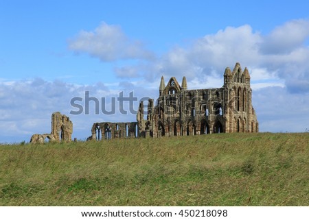 Whitby, England - 8 July, 2016: Whitby Abbey is a ruined Benedictine Abbey in North Yorkshire and was an inspiration for the Dracula story by Bram Stoker.