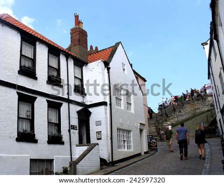 WHITBY, NORTH YORKSHIRE, ENGLAND - 20th May 2014: Whitby resort on the 20th May 2014. This is a popular tourist destination every summer, particularly from visitors from European countries.  - stock photo
