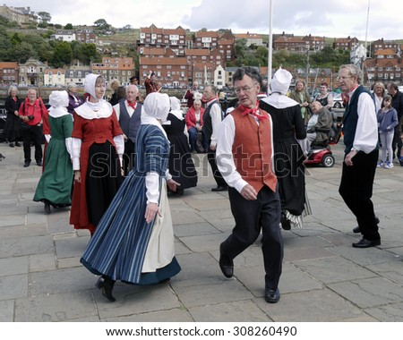 WHITBY, NORTH YORKSHIRE, UK. Circa AUGUST 2014. Traditional dancers performing at the Whitby folk festival. - stock photo