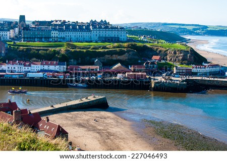 Whitby, North Yorkshire, UK - October 12, 2014: Scenic view of Whitby city in autumn sunny day.Whitby is a seaside town and port in North Yorkshire, UK