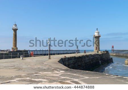 Whitby, North Yorkshire, UK;  the Lighthouses on the East and West Piers - stock photo