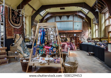 Whitby, UK August 17, 2016: An indoor market in an old converted church hall selling various craft items including rugs, baskets and bags.