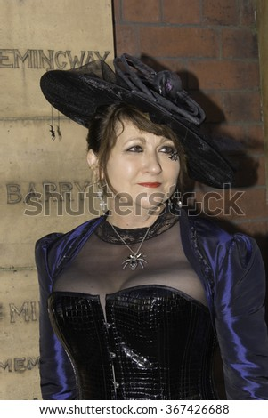 Whitby, UK - November 1, 2014: Whitby Goth Weekend, often abbreviated to WGW is a twice-yearly music festival for goths, in Whitby, North Yorkshire, England.  Mature female in classic black costume