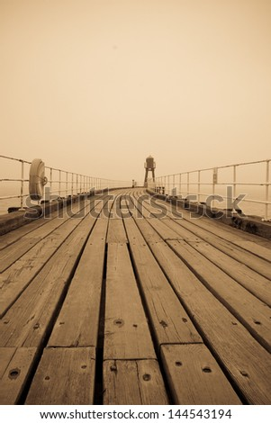 Whitby west pier on a foggy day - stock photo