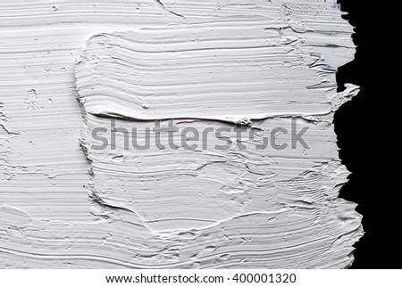 white abstract painting - oil paint on black background - stock photo